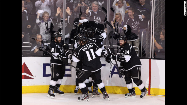 Dustin Brown's Kings teammates celebrate one of his two first period goals Monday.