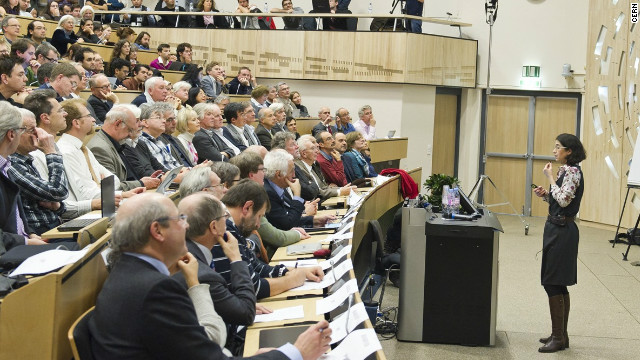 Last December, hundreds of scientists gathered to hear and applaud Gianotti's update on the ATLAS team's search for the Higgs Boson particle.