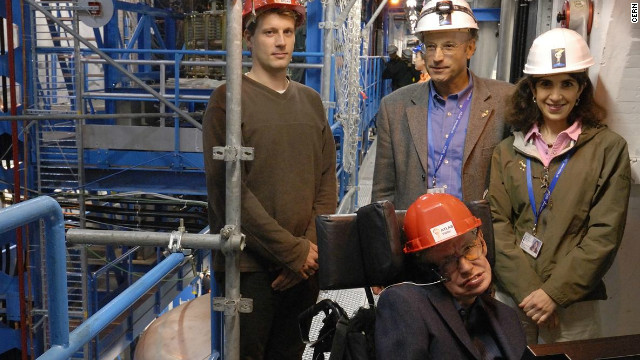 Gianotti accompanies theoretical physicist Stephen Hawking on a tour of the ATLAS cavern in 2006.