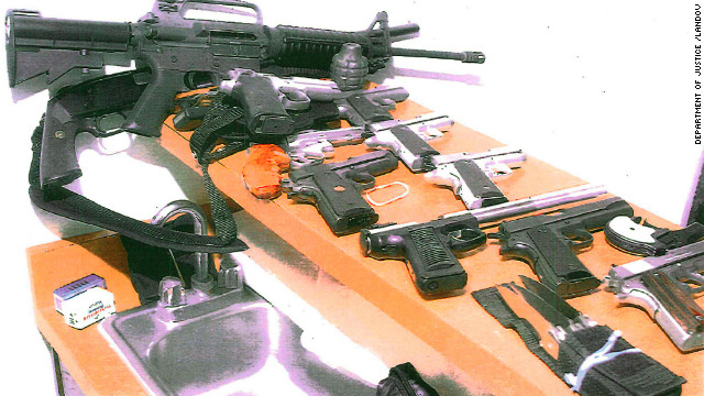 FBI agents found assault rifles, a 12-gauge shotgun, many semi-automatic pistols and revolvers, a silencer, a Derringer pistol, multiple hunting knives and bundles of cash inside the couple's two-bedroom apartment.