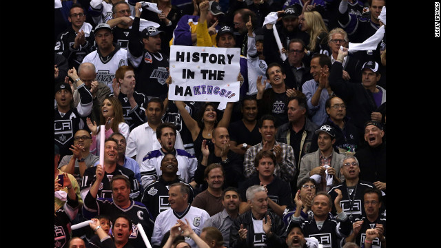 A Kings fan holds up a sign that reads, &quot;History in the Makings.&quot; Leading up to game six, the team's 3-0 series lead was cut to 3-2.