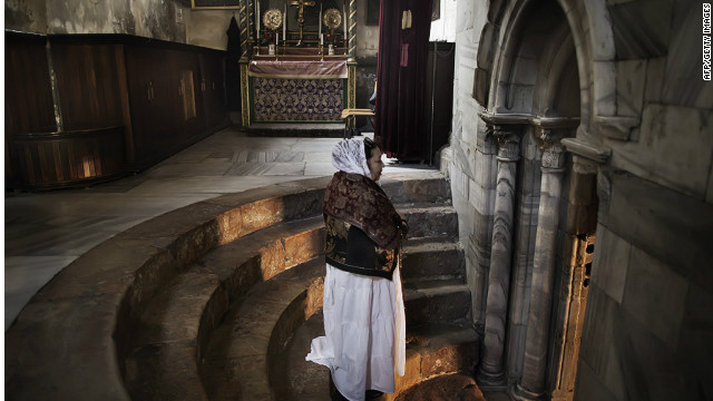 Bethlehem's Church of the Nativity could become the first World Heritage site in the Palestinian Territories. Pictured, a pilgrim prays at the entrance to the church's grotto, considered the site of Christ's birth since at least the 2nd century.