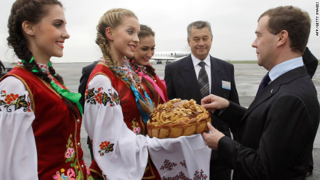 Ukrainian cuisine is known for its simplicity. Bread is a main part of the national diet and the country has been known as the 'breadbasket of Europe'. Pictured: Former Russian president Medvedev receieves a tradtional greeting arriving in Ukraine in 2010.