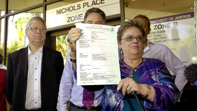 Lindy Chamberlain-Creighton shows reporters Azaria's death certificate outside a Darwin court Tuesday after coroner Elizabeth Morris rules that a dingo caused her baby's death 32 years ago.