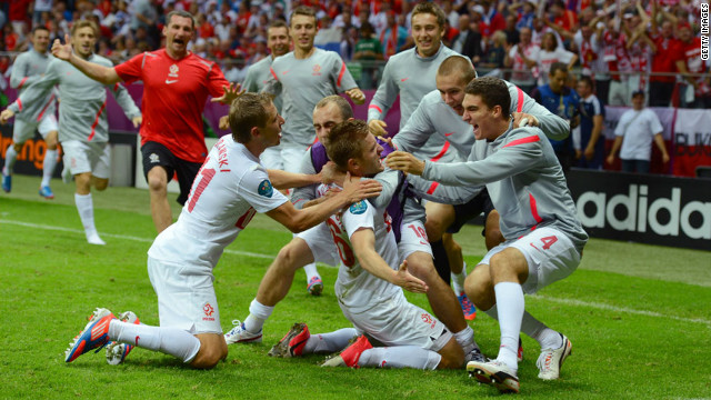 Jakub Blaszczykowski of Poland celebrates after scoring Poland's equalizer in the 1-1 draw with Russia in Warsaw, Poland, on Tuesday, June 12.