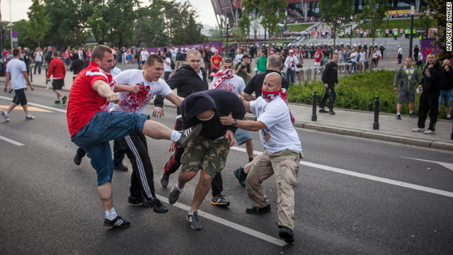 Euro 2012: Russia and Poland fans clash in Warsaw