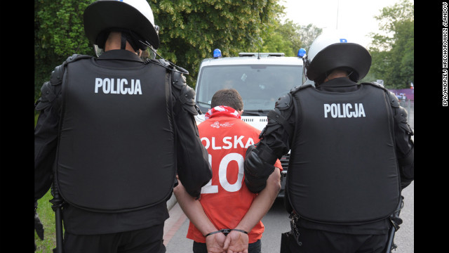  A Polish fan is arrested by police before the Russia-Poland match.