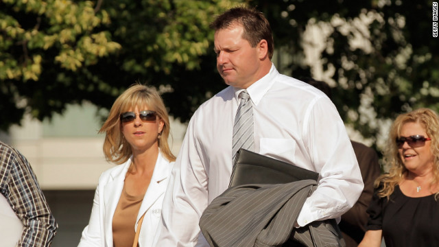 Former baseball pitcher Roger Clemens is joined by his wife, Debbie Clemens, at the U.S. District Court in Washington.