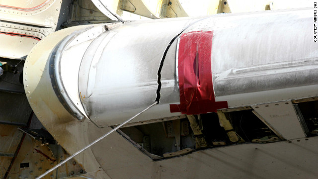 A close-up view of an airplane wing being dismantled. Valuable parts can be sold on by plane owners at a profit while any remaining scrap metal is broken down for resale by Tarmac. 