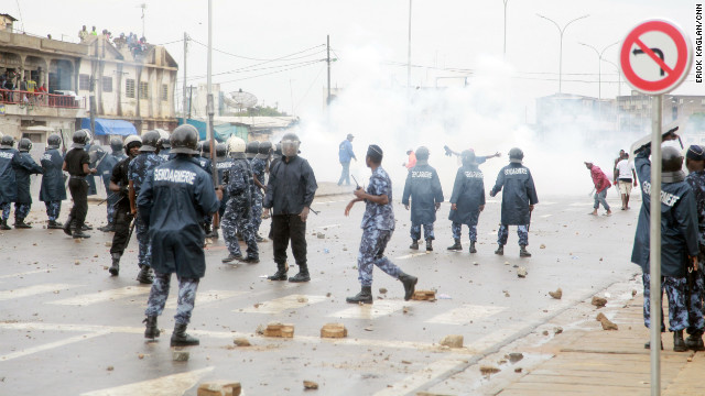 Togolese security forces shoot tear gas at protesters demonstrating against a new electoral law.