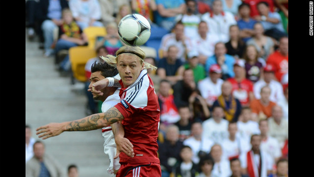 Denmark's Simon Kjær battles for a header against Helder Postiga of Portugal on Wednesday.