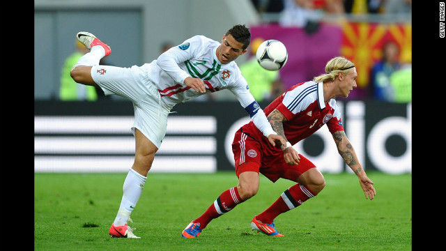 Cristiano Ronaldo of Portugal clashes with Simon Kjr of Denmark during the Group B match between Portugal and Denmark.