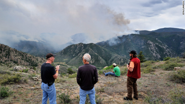 Residents watch the approaching fire Tuesday in the Roosevelt National Forest west of Fort Collins.