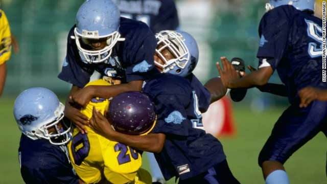 Players compete during the Pop Warner Pee Wee Football Super Bowl in Orlando, Florida.