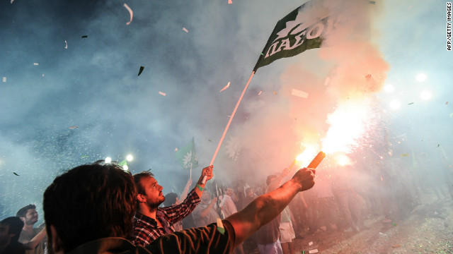 Supporters of the Greek socialist party Pasok set off fireworks during a pre-election campaign rally in Athens on June 13, 2012. The country is set to go to the polls for a second time on June 17 after failing to form a government following the May 6 election.