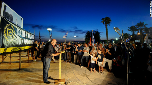 "Ilias Panagiotaros, member of extreme right ultra nationalist party Golden Dawn (Chrysi Avgi), speaks during a pre-election rally in Athens on June 11, 2012. He caused controversy after saying: ""If Chrysi Avgi gets into parliament it will carry out raids on hospitals and kindergartens and it will throw immigrants and their children out on the street so that Greeks can take their place."""