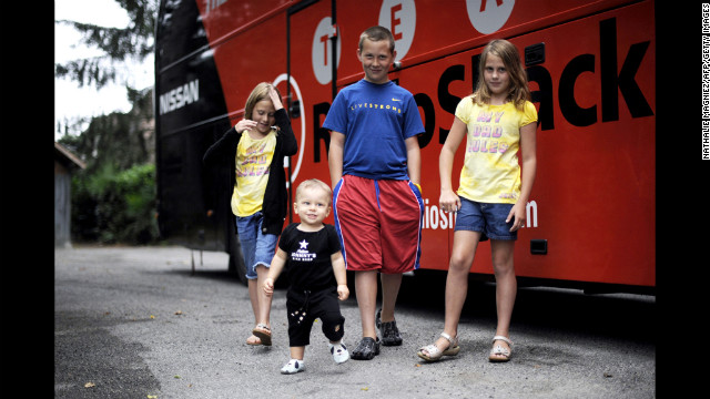 Armstrong's son Luke; twin daughters, Isabelle and Grace; and 1-year-old son, Max, stand outside the Radioshack team bus on a rest day during the 2010 Tour de France.