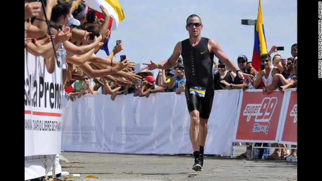 Armstrong competes in the 70.3 Ironman Triathlon in Panama City, Florida, in February 2012. He went on to claim two Half Ironman triathlon titles by June of that year.