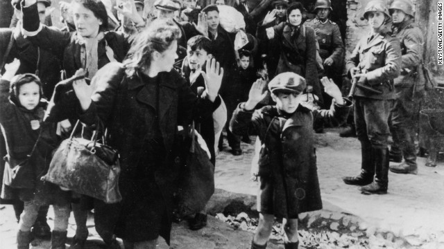 This image shows terrified women and children from the Warsaw ghetto in Nazi-occupied Poland surrendering to German soldiers after a failed uprising in1943.