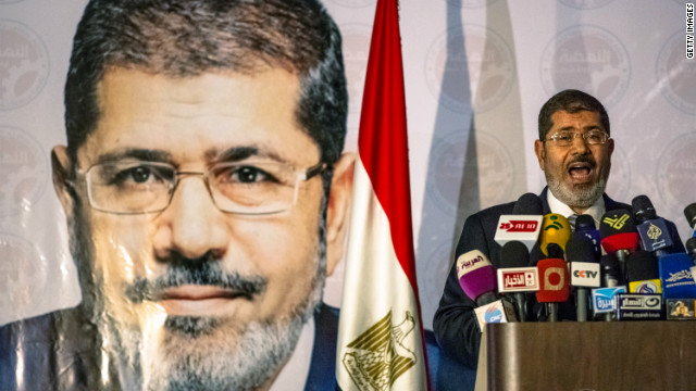 Presidential candidate Mohamed Morsi of the Muslim Brotherhood, who is set for a runoff election against Ahmed Shafiq, speaks at a press conference in Cairo on Wednesday, June 13.