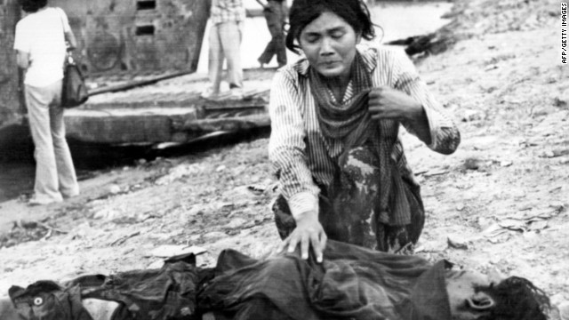 A woman cries next to a dead body in April 1975 in Phnom Penh after the Khmer Rouge enter the Cambodian capital and establish government of Democratic Kampuchea (DK).