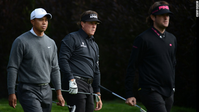 "From left, Tiger Woods, Phil Mickelson and Bubba Watson wait on the 13th tee during the first round.The trio teed off together in what many called a ""super group."""