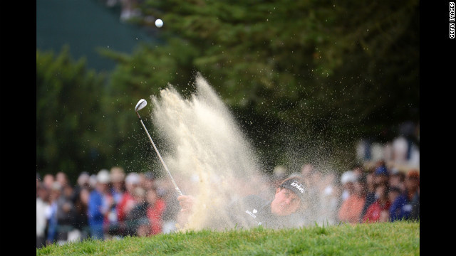 Mickelson blasts out of the bunker on the 10th hole.
