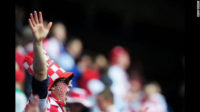 Fans revel during the Italy-Croatia match on Thursday.