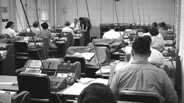 The office, 1961: Norfolk & Western employees sit at IBM punch card machines.