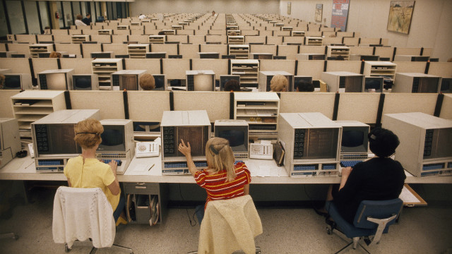 The office, 1970s: Eastern Airlines operators man computers at the reservations center.