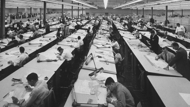 The office, 1960s: Aerojet designers do their work at a series of long tables.