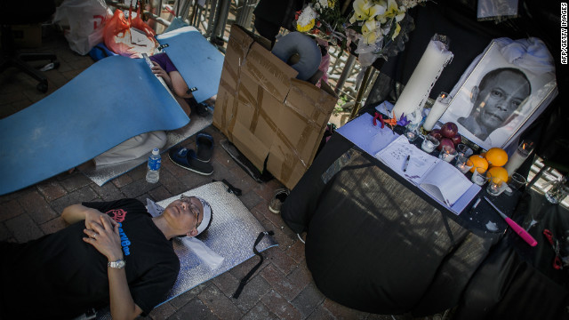 An activist in Hong Kong closes his eyes during a hunger strike next to the portrait of late Chinese dissident Li Wangyang. Li was found dead in suspicious circumstances in his hospital ward in southcentral China's Hunan province.