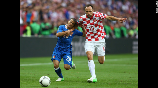 Gordon Schildenfeld of Croatia and Sebastian Giovinco of Italy battle for the ball.