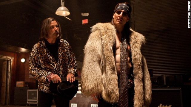 Alec Baldwin, left, stars as Dennis Dupree and Tom Cruise stars as Stacee Jaxx in Adam Shankman's
