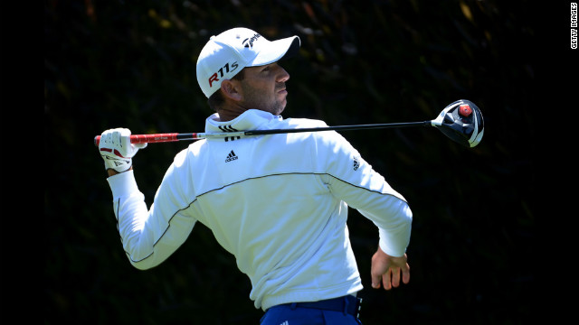 Sergio Garcia of Spain watches his tee shot on the first hole during the first round.