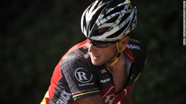Lance Armstrong looks back as he rides in a breakaway during the 2010 Tour de France.
