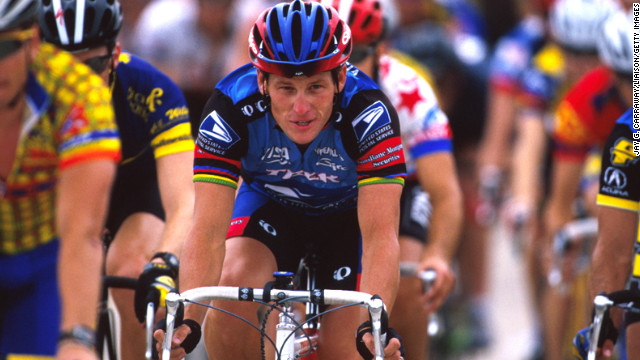 Armstrong rides for charity in May 1998 at the Ikon Ride for the Roses to benefit the Lance Armstrong Foundation. He established the foundation to benefit cancer research after being diagnosed with testicular cancer in 1996. After treatment, he was declared cancer-free in February 1997.