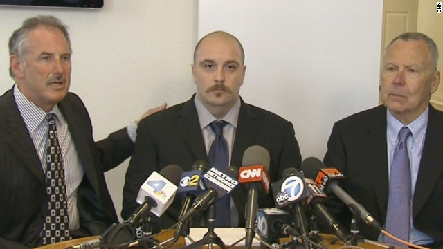 Former security guard Michael Reeves and his attorneys, Stephen Solomon and Stephen Jamieson.