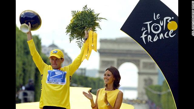 Armstrong celebrates on the podium after winning the Tour de France by 61 seconds in 2003. It was his fifth consecutive win.