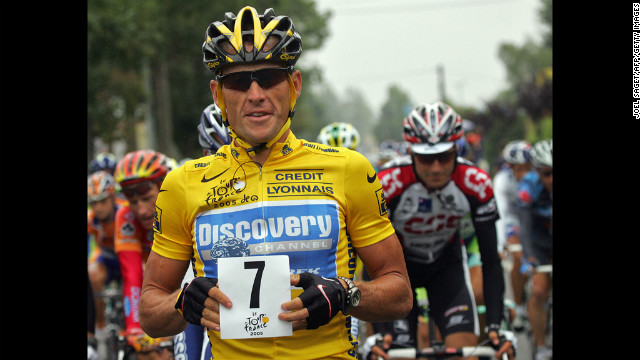 Armstrong holds up a paper displaying the number seven at the start of the Tour de France in 2005. He went on to win his seventh consecutive victory.