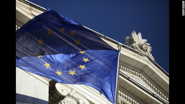 A European Union flag flies outside the National Bank of Greece SA in Athens on Thursday, June 14.