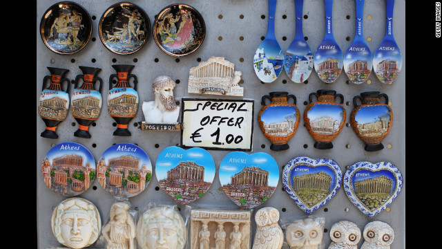 Refrigerator magnets are for sale in a gift shop in the district of Plaka.