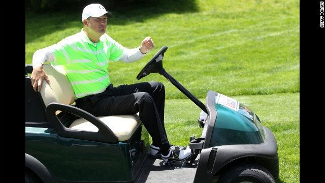Casey Martin drives a golf cart off the first hole during the first round of the 112th U.S. Open on Thursday.