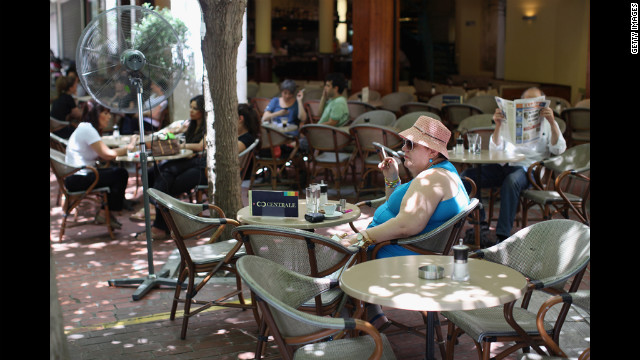 A woman sits in a cafe in Plaka.