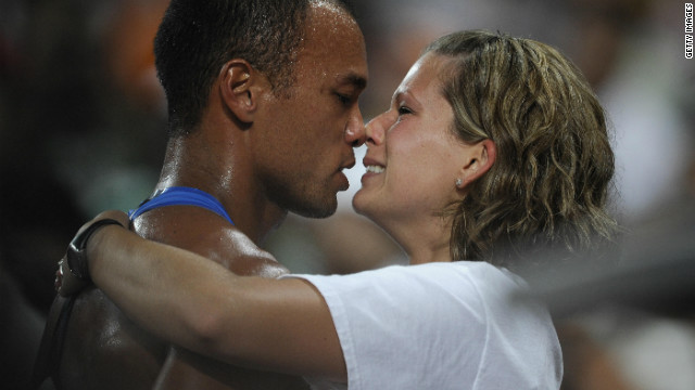 Clay and his wife Sarah, who he married in 2004, share an emotional moment after his Beijing triumph.