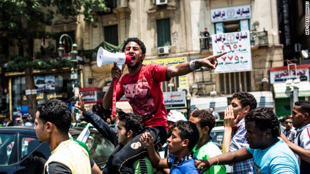 Egyptians protest in Tahrir Square on Friday after Egypt's Supreme Constitutional Court ruled that Parliament must be dissolved.