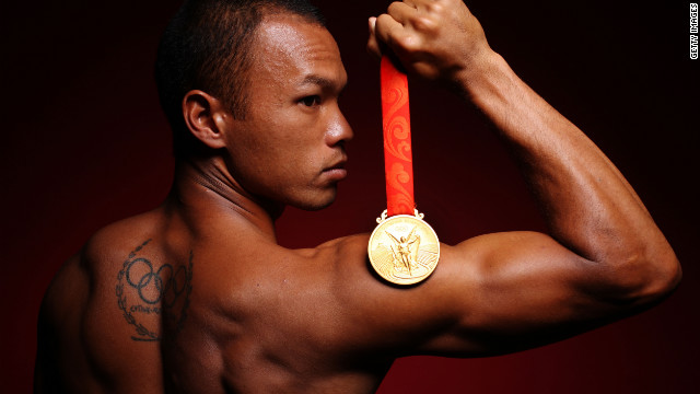 American decathlete Bryan Clay shows off his 2008 Olympic gold medal in a publicity shot.