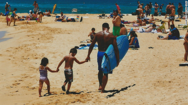 Clay walks on a California beach with two of his three young children.