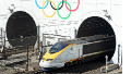 Olympic Rings marking the London 2012 Olympic Games are painted on the entrance to the Channel Tunnel as a Eurostar high-speed train travels through, before arriving at the Eurotunnel terminal in Coquelles, near Calais, northern France, on march 29, 2012.
