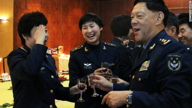People's Liberation Army (PLA) Air Force fighter pilot Liu Yang, center in a 2010 photo, will be China's first female 'taikonaut.'